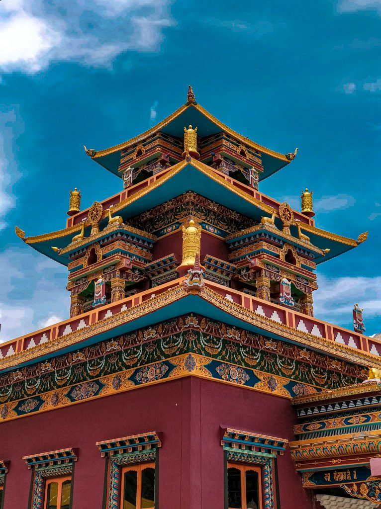 blue and brown temple under blue sky during daytime